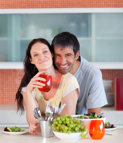 lovely couple eating and drinking in the kitchen