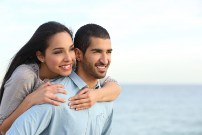 portrait of happy couple with sea in the background